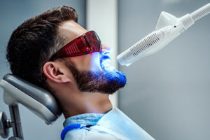 fluoride treatments tx, man getting dental treatment