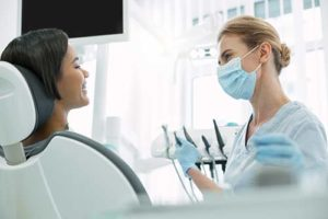 emergency dentist talking with patient about dental emergency